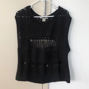 Sleeveless sweater with trendy rips